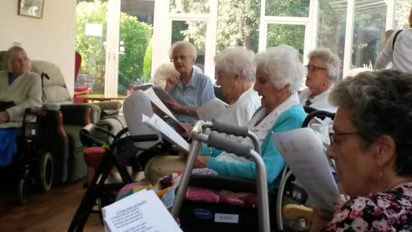 Photo of residents at St Dominics enjoying Harvest  with Alberto