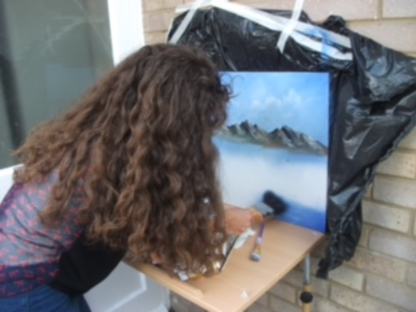 Student painting a scene from the Lake District