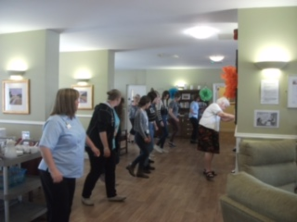 Students Line Dancing with residents